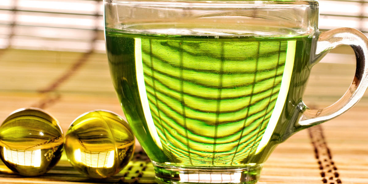 Сок растения в чашке фотография